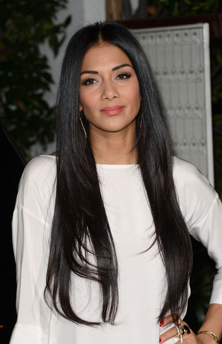 LOS ANGELES, CA - FEBRUARY 13:  Singer Nicole Scherzinger arrives at the Topshop Topman LA Opening Party at Cecconi's West Ho