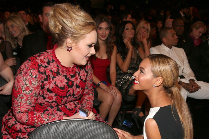 LOS ANGELES, CA - FEBRUARY 10:  Singers Adele (L) and Beyonce attend the 55th Annual GRAMMY Awards at STAPLES Center on Febru
