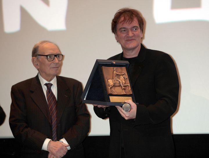 ROME, ITALY - JANUARY 04:  Director Quentin Tarantino (R) receives Rome Film Festival Lifetime Achievement Award from Italian