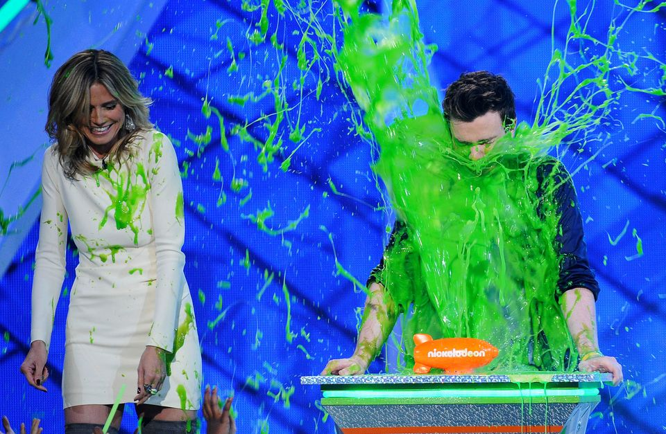 LOS ANGELES, CA - MARCH 31:  Model Heidi Klum and actor Chris Colfer speaks onstage at Nickelodeon's 25th Annual Kids' Choice
