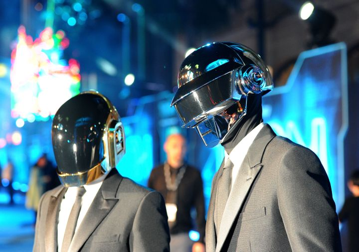 Musicians Thomas Bangalter and Guy-Manuel de Homem-Christo of Daft Punk arrive at Walt Disney's 'TRON: Legacy' World Premiere