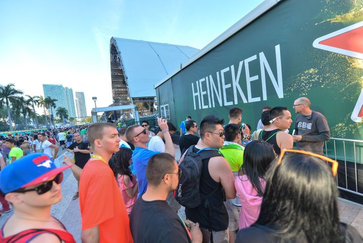 MIAMI, Fl - MARCH 15:  Festival-goers don't miss a beat while getting a beer in Heineken's immersive new installation at Ultr