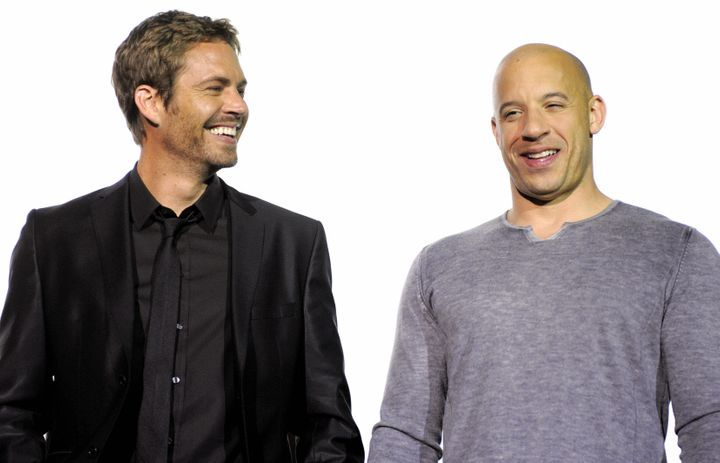 US actors Vin Diesel (R) and Paul Walker pose during a photocall ahead of the European premiere of the movie 'Fast & Furious'