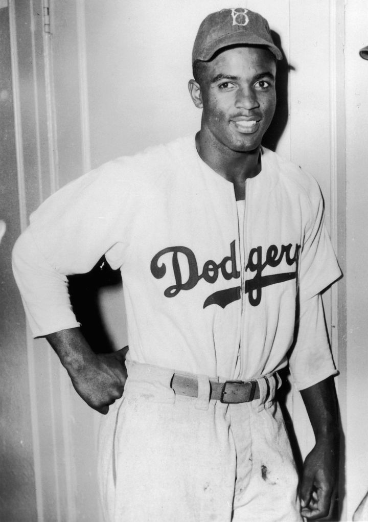 circa 1945:  American baseball player Jackie Robinson (1919-1972) leans against a door in his Brooklyn Dodgers uniform.  (Pho