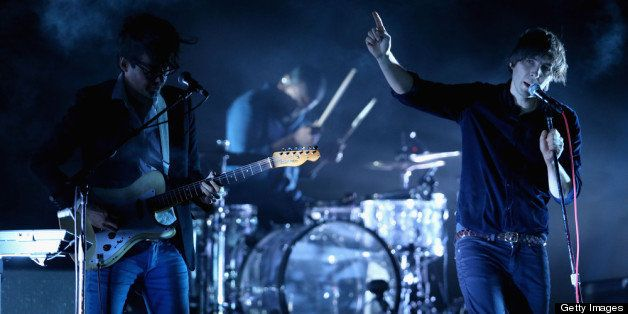 INDIO, CA - APRIL 13:  Musicians Laurent Brancowitz and Thomas Mars of Phoenix perform onstage during day 2 of the 2013 Coach