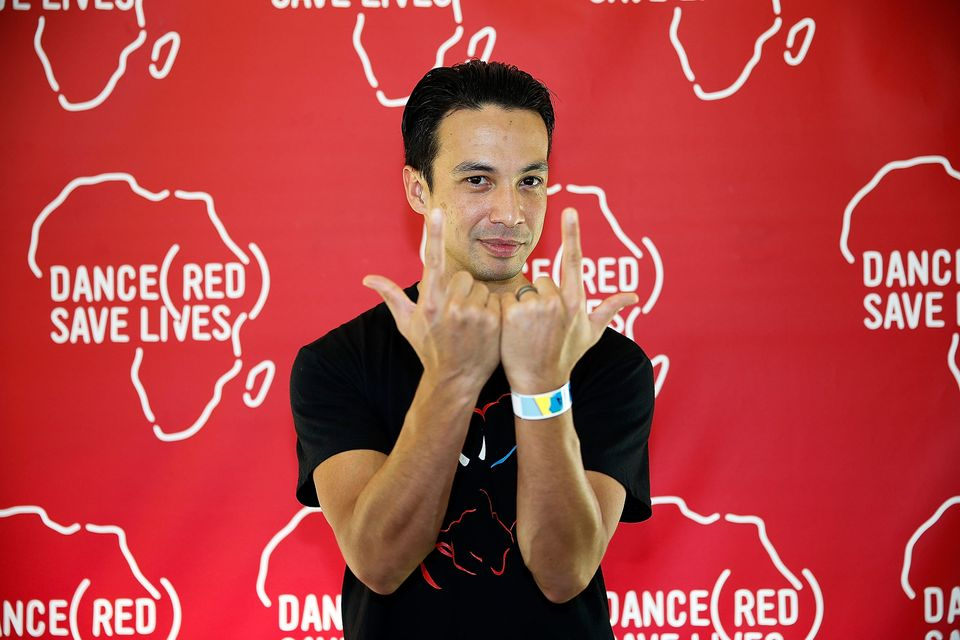 In this photo provided by (RED), Laidback Luke poses backstage for DANCE (RED), SAVE LIVES during Stereosonic 2012 at Melbour