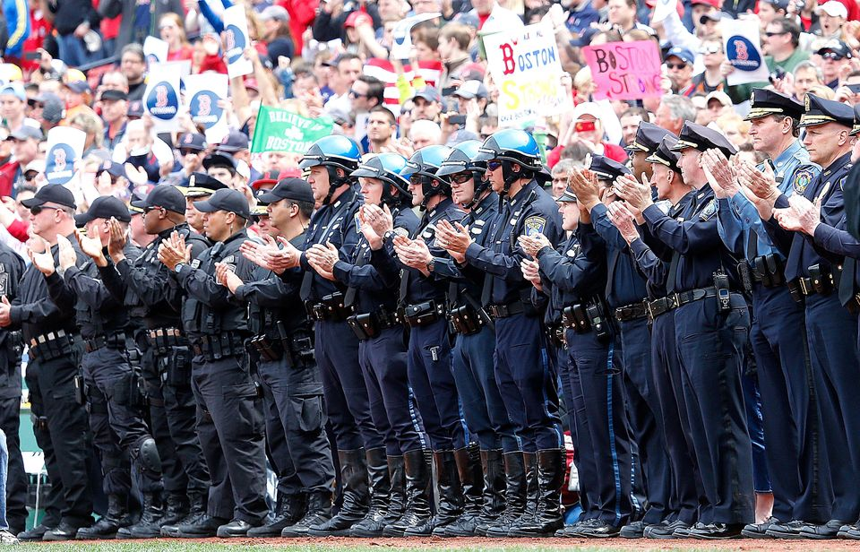 BOSTON, MA - APRIL 20: Members of law enforcement react during pre-game ceremonies in honor of the Marathon bombing victims b