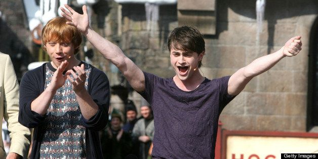 Harry Potter films star Daniel Radcliffe, right, cheers with the crowd, with co-star Rupert Grint during the official grand o
