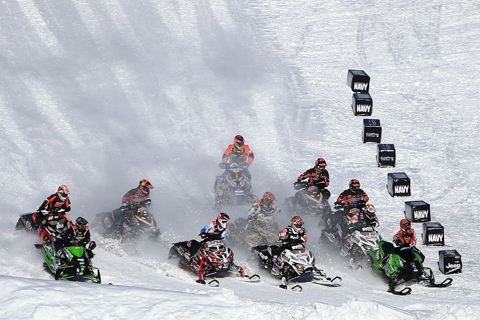 ASPEN, CO - JANUARY 27:  Competitors race for the hole shot in the first round of Snowmobile Snocross at Winter X Games Aspen