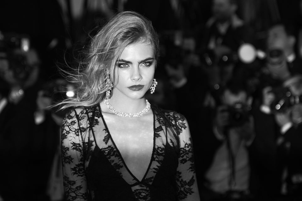 BLACK AND WHITE VERSION British model Cara Delevingne poses on May 15, 2013 as she arrives for the screening of the film 'The