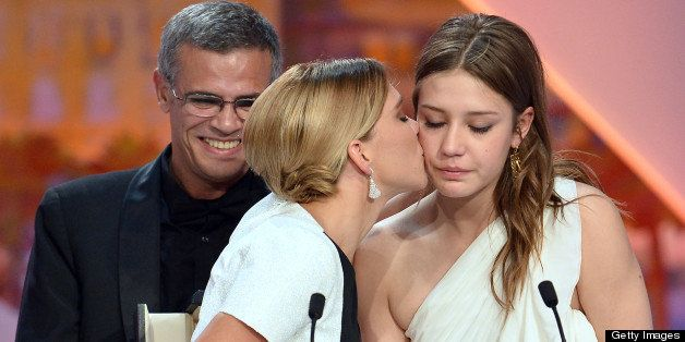 French actress Lea Seydoux (L) kisses on May 26, 2013 fellow actress Adele Exarchopoulos after French-Tunisian director Abdel