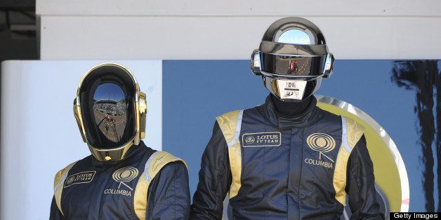 French Daft Punk band members pose in the pits at the Monaco Formula One Grand Prix at the Circuit de Monaco in Monte Carlo o