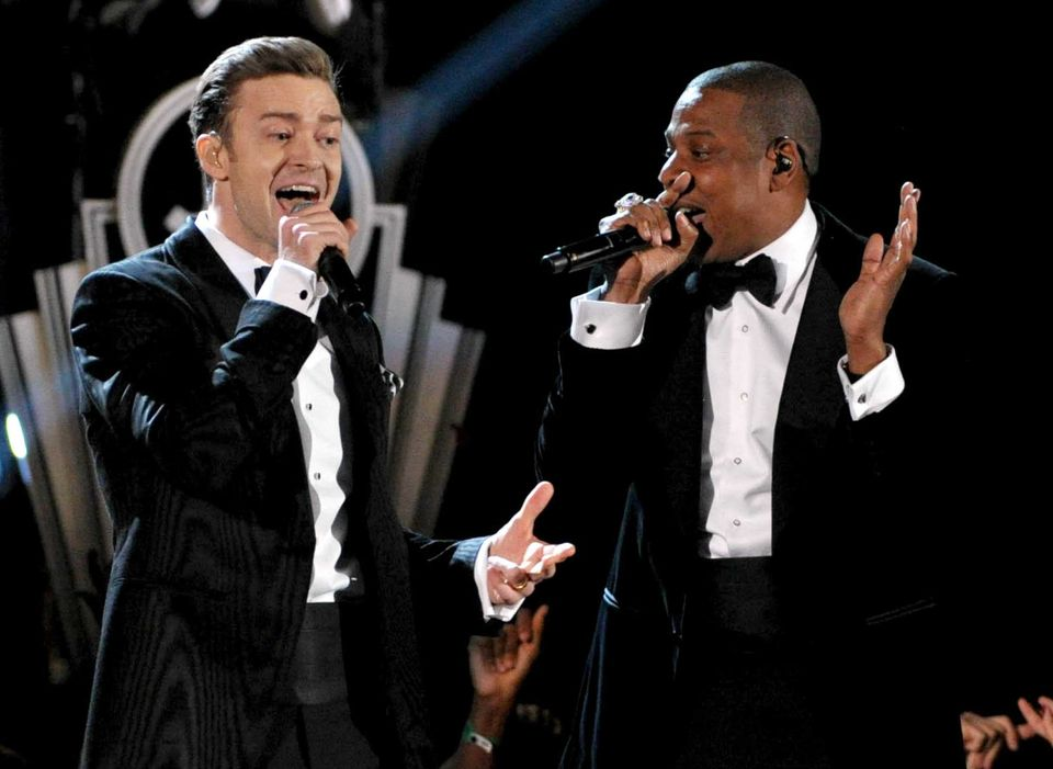 FILE - This Feb. 10, 2013 file photo shows recording artists Just Timberlake, left, and Jay-Z performing at the 55th annual G