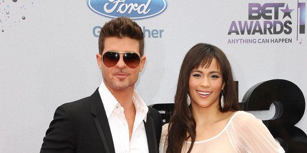 LOS ANGELES, CA - JUNE 30:  Singer Robin Thicke and actress Paula Patton attend the 2013 BET Awards at Nokia Theatre L.A. Liv