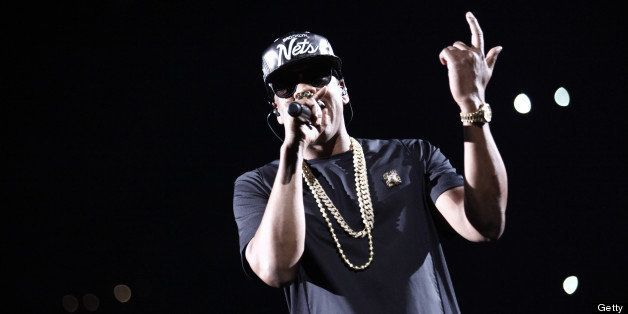 US rapper Jay-Z performs during a concert as part of their tour 'Watch the Throne' on June 1, 2012 in Paris Bercy. AFP PHOTO
