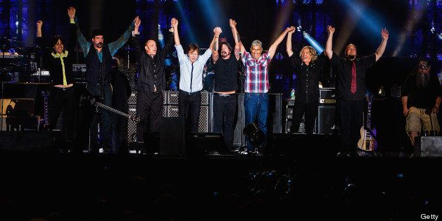 SEATTLE, WA - JULY 19:  Sir Paul McCartney performs on stage with members of Nirvana at Safeco Field on July 19, 2013 in Seat