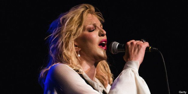 SEATTLE, WA - JULY 23:  Courtney Love performs on stage at The Moore Theater on July 23, 2013 in Seattle, Washington.  (Photo