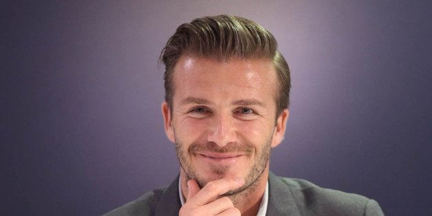 This picture taken on June 25, 2013 shows football superstar David Beckham attending a promotional event in Beijing. Football