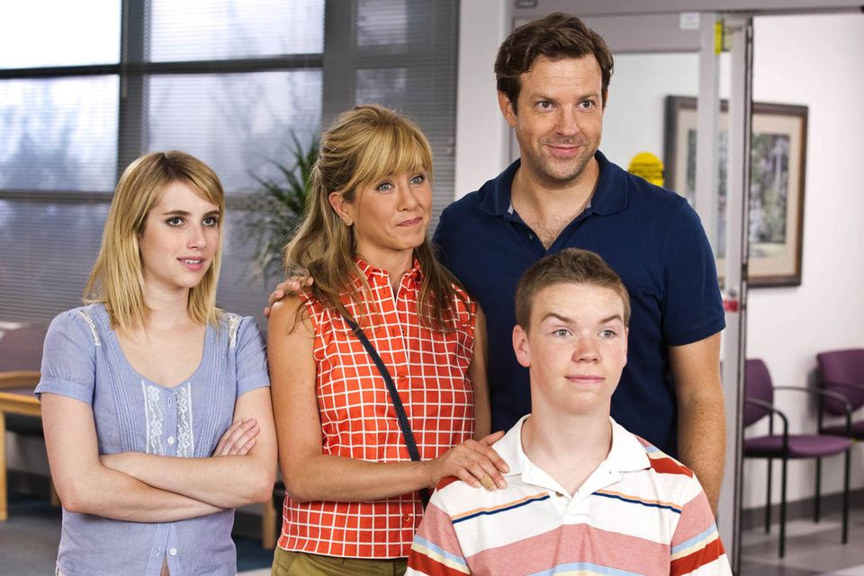 This film image released by Warner Bros. Entertainment shows, from left, Emma Roberts, Jennifer Aniston, Jason Sudeikis, back