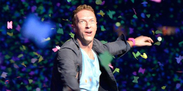 BRISBANE, AUSTRALIA - NOVEMBER 21:  Chris Martin of Coldplay performs live for fans at Suncorp Stadium on November 21, 2012 i