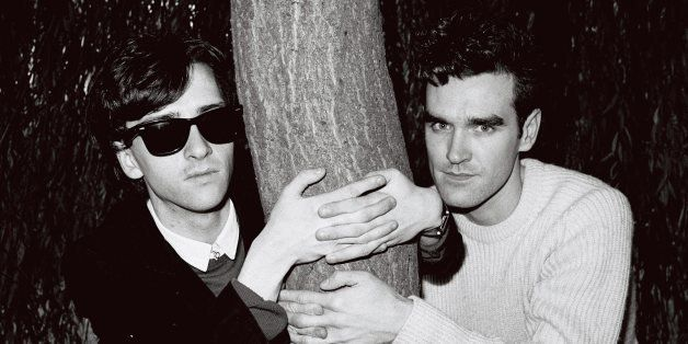 LONDON - 1st JANUARY: Johnny Marr (left) and Morrissey from The Smiths posed with their arms around a tree trunk in London in