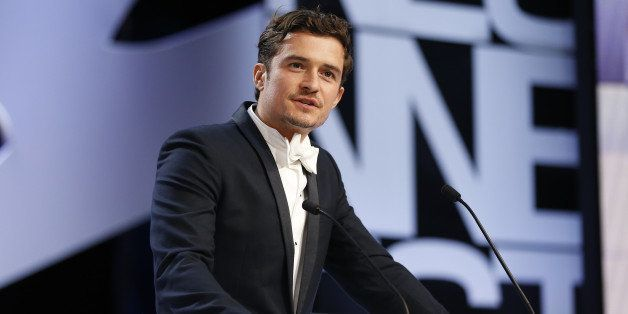 British actor Orlando Bloom speaks on stage to announce on May 26, 2013 the Prix d'Interpretation Feminine (Best Actress) dur