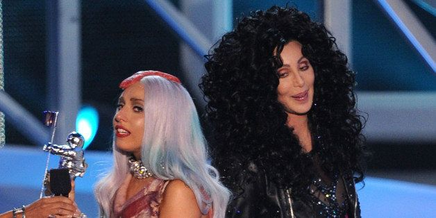 LOS ANGELES, CA - SEPTEMBER 12:  Singer Lady Gaga accepts the Video of the Yearaward from Cher onstage during the 2010 MTV Vi