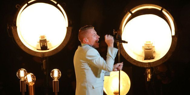 NEW YORK, NY - AUGUST 25:  Macklemore performs onstage during the 2013 MTV Video Music Awards at the Barclays Center on Augus