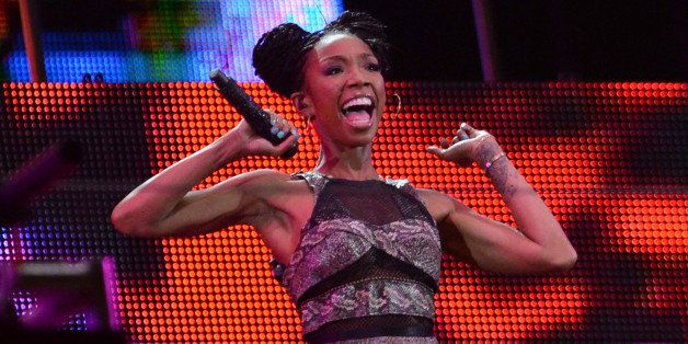 SOWETO, SOUTH AFRICA: (SOUTH AFRICA OUT) Brandy performs during the Nelson Mandela Sports & Cultural day music concert at the