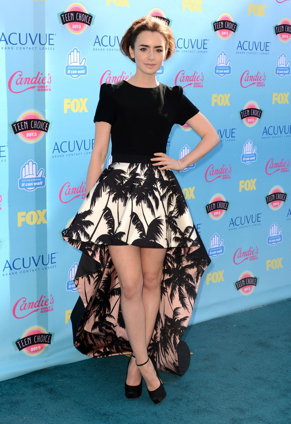 Lily Collins arrives at the Teen Choice Awards at the Gibson Amphitheater on Sunday, Aug. 11, 2013, in Los Angeles. (Photo by