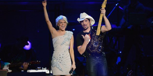 LAS VEGAS, NV - APRIL 07:  Musicians Carrie Underwood and Brad Paisley perform onstage during the 48th Annual Academy Of Coun