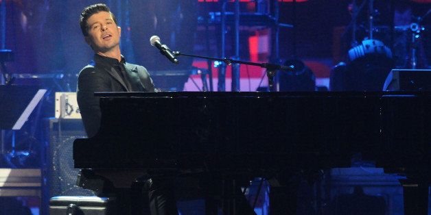Singer Robin Thicke performs at the BET-SOS Saving Ourselves - Help for Haiti Benefit Concert at AmericanAirlines Arena on Fe