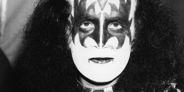 Portrait of Israeli-born American pop singer Gene Simmons of the band KISS as he wears the makeup, leather and chains costume