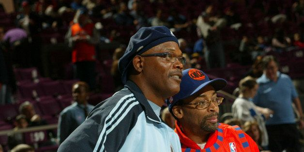 NEW YORK - DECEMBER 12:  Actor Samuel  L. Jackson, Director Spike Lee and son Satchel stand courtside at the New York Knicks