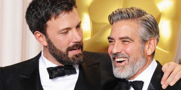 HOLLYWOOD, CA - FEBRUARY 24:  Actor/producers Ben Affleck (L) and George Clooney pose in the press room during the Oscars at