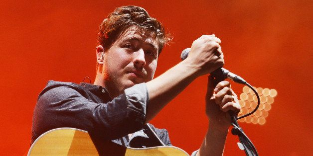 NEW YORK, NY - AUGUST 28:  Singer/musician Marcus Mumford of Mumford and Sons performs at Forest Hills Stadium on August 28,