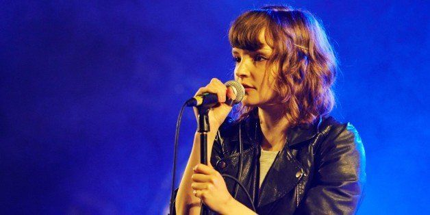 LEEDS, UNITED KINGDOM - AUGUST 24: Lauren Mayberry of Chvrches performs on stage on Day 2 of Leeds Festival 2013 at Bramham P
