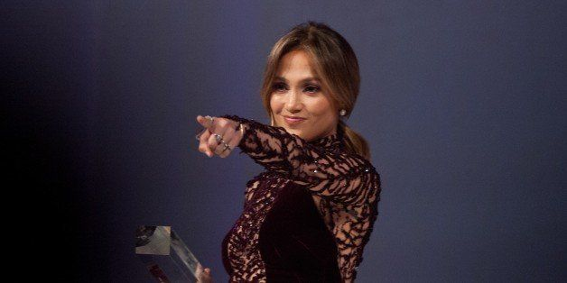US singer and actress Jennifer Lopez points to the audience as she leaves the stage after receiving the Ally for Equality Awa