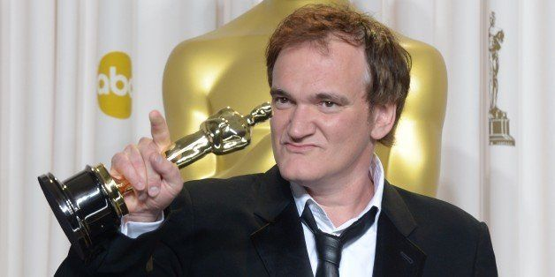 Quentin Tarantino holds the trophy for Best Original Screenplay in the press room during the 85th Annual Academy Awards on Fe