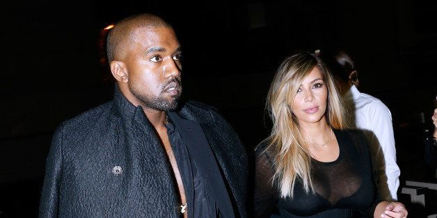 PARIS, FRANCE - SEPTEMBER 29:  Kim Kardashian and Kanye West arriving at Givenchy show as part of the Paris Fashion Week Wome