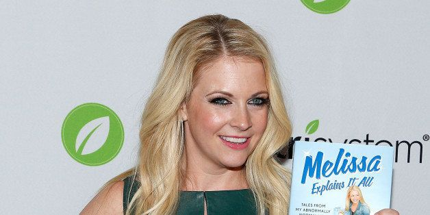 NEW YORK, NY - OCTOBER 29:  Actress/author Melissa Joan Hart poses for a photo witha copy of her new book 'Melissa Explains I