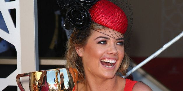 MELBOURNE, AUSTRALIA - NOVEMBER 05:  Kate Upton poses with the Melbourne Cup during Melbourne Cup Day at Flemington Racecours