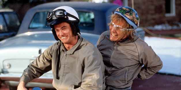 Jim Carrey and Jeff Daniels riding bike in a scene from the film 'Dumb & Dumber', 1994. (Photo by New Line Cinema/Getty Image