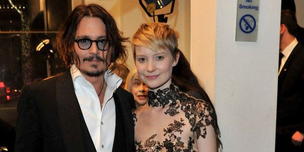LONDON, ENGLAND - FEBRUARY 25:  Actor Johnny Depp and actress Mia Wasikowska attend the Royal World Premiere of Tim Burton's