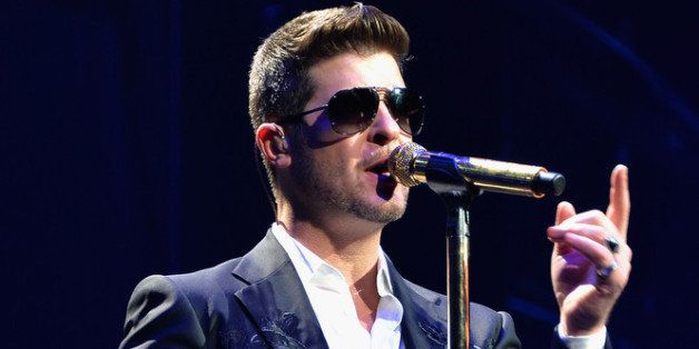 PHILADELPHIA, PA - DECEMBER 04:  Singer Robin Thicke performs onstage during Q102's Jingle Ball 2013 presented by Bernie Robb