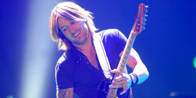 FAIRFAX, VA - NOVEMBER 23: Keith Urban performs at the Patriot Center on November 23, 2013 in Fairfax, Virginia. (Photo by ML
