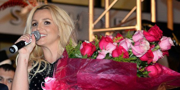LAS VEGAS, NV - DECEMBER 03: Singer Britney Spears holds a bouquet of flowers at a welcome ceremony as she celebrates the release of her new album 'Britney Jean' and prepares for her two-year residency at Planet Hollywood Resort & Casino on December 3, 2013 in Las Vegas, Nevada. Spears' show 'Britney: Piece of Me' will debut at the resort on December 27, 2013. (Photo by Ethan Miller/Getty Images)