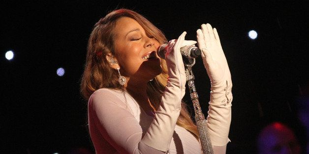 WASHINGTON, DC - DECEMBER 06:  Mariah Carey performs during the National Christmas Tree Lighting Ceremony in President's Park