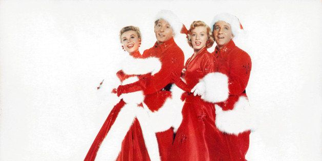 Vera-Ellen, Danny Kaye, Rosemary Clooney and Bing Crosby dressed in Christmas stage costumes in a scene from the film 'White