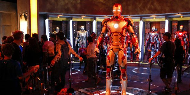 Guests tour suits of Marvel's Iron Man armor in the Iron Man Tech Presented by Stark Industries exhibit at Walt Disney Co.'s
